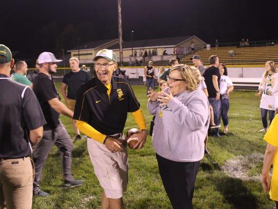 Edgar head football coach Jerry Sinz jokes with a community