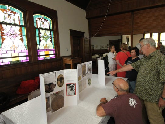 Elmer Hall (standing) played a key role in putting together the events that included an exhibit profiling Madison County WWI veterans at Dorland Presbyterian Church.
