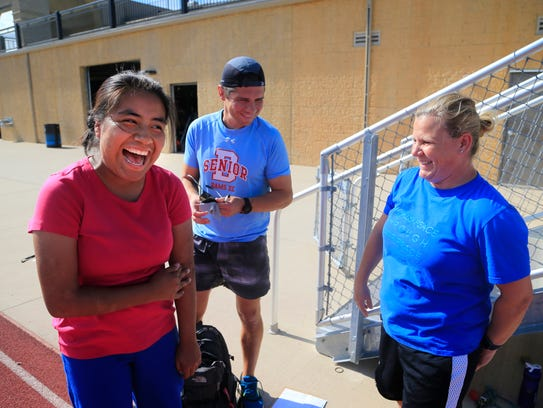 Wendy Flores jokes with her cross country coach Louis