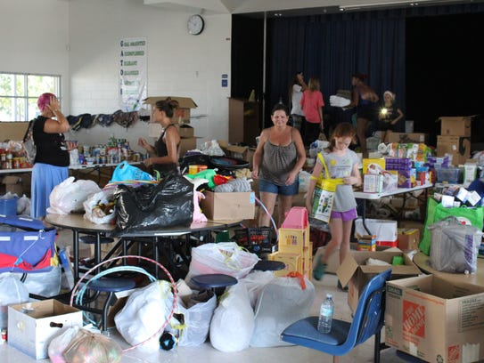 Volunteers worked feverishly to unload and organize