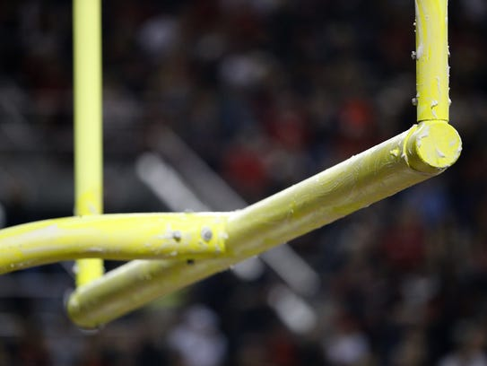 Goalposts are greased up in anticipation of a Miami