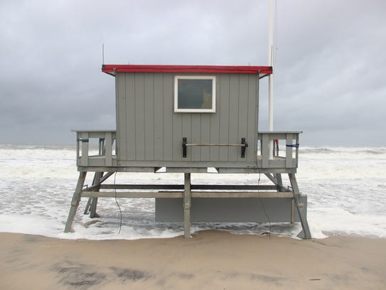 A lifeguard stand gets pounded by surf at Assateague