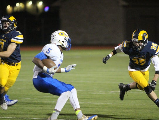 Jaylen Carter looks for a seam on his way upfield for