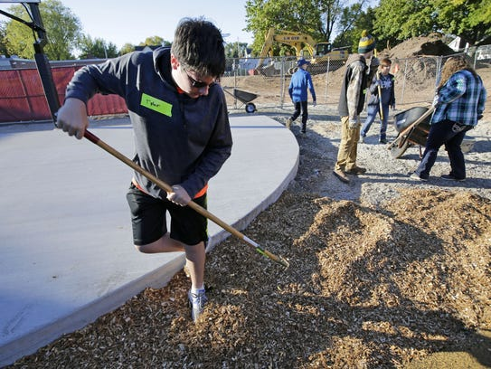 Tyler Thiel of Shawano joins other volunteers on Saturday
