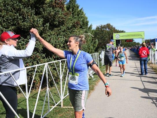 Marathon finisher Grace Kassander (right) greets  Milwaukee