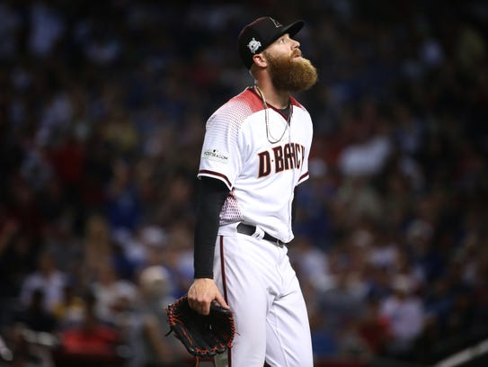 Reliever Archie Bradley reacts to being pulled from