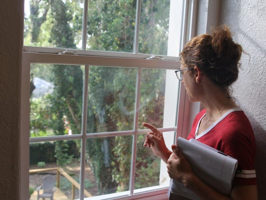 Leon County Commissioner Kristin Dozier looks out from