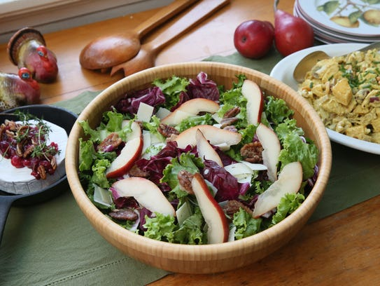 This fall salad tosses greens with apples, candied