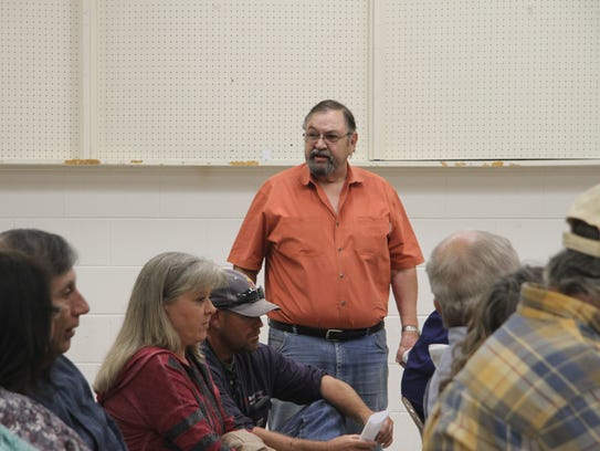 Otis water user Larry Coalson address the board and