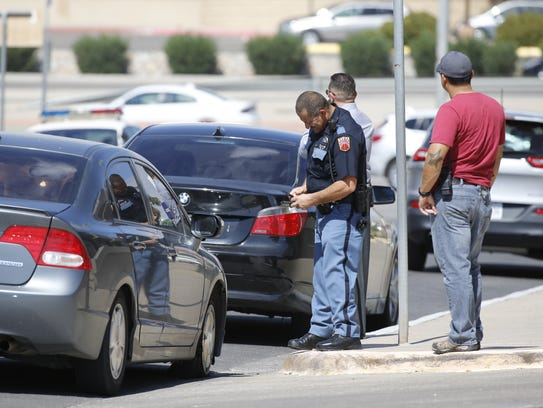 An El Paso police officer investigates after a car