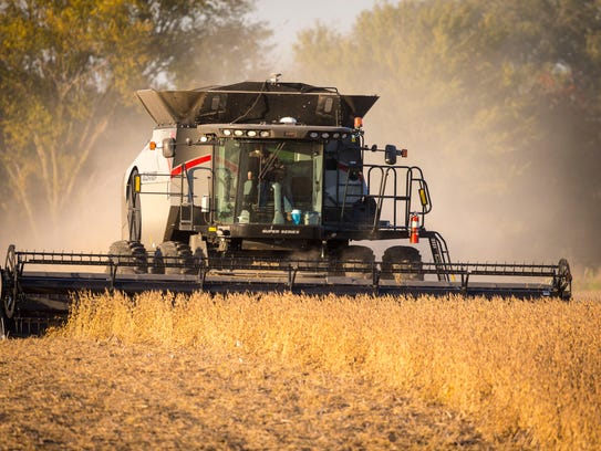 Roger Zylstra harvests soybeans at one of his fields near Kellogg, Iowa, Wednesday, Oct. 18, 2017.