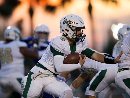 St. John Neumann quarterback Jensen Jones (5) carries