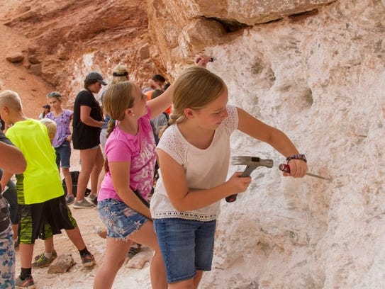 "Visitors gather gypsum at ""Glitter Mine"", an active"