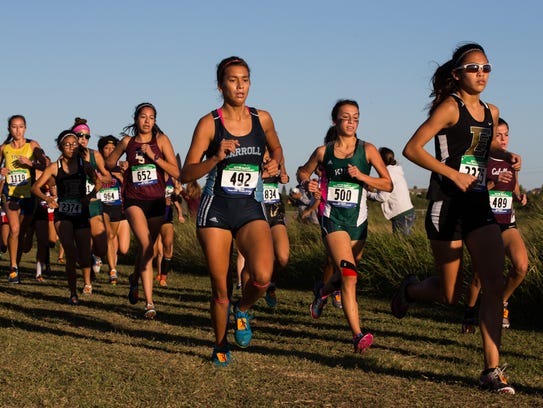 The girls 5A race during the Region IV Cross country