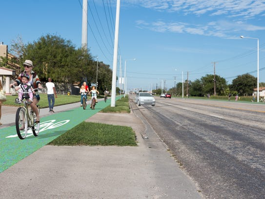 Pictured is a rendering of a proposed cycle track (painted