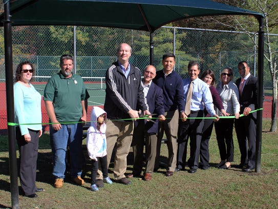 Cutting the ribbon on improvements to Woods Edge Park