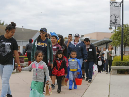 Students line up to on Halloween at Little Bear Creek