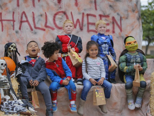 Little Bear Creek preschoolers pose for a Halloween