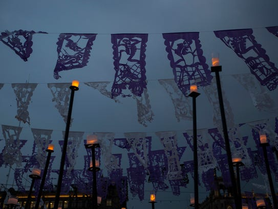 Decorative paper flags with skeleton figures hang above