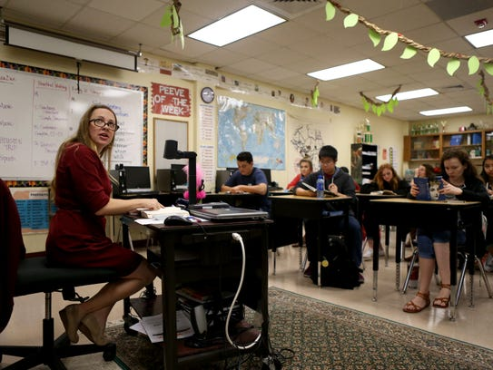 English teacher Sarah Walker reads with her students