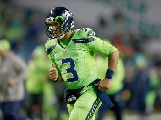 """Russell Wilson dons Seattle's """"Action Green"""" Color"""
