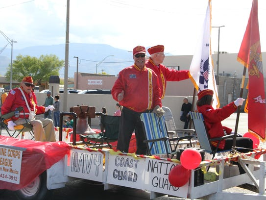 In this file photo, a veteran gives the thumbs up while riding on the Marine Corps League float during the Veterans Day Parade in 2016.