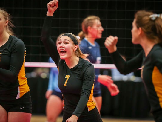 Waverly-Shell Rock's Claire Marsh celebrates with teammates