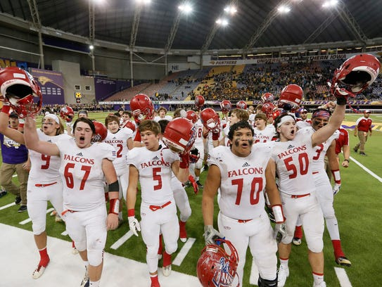 West Sioux celebrates their 55-21 win over St. Albert
