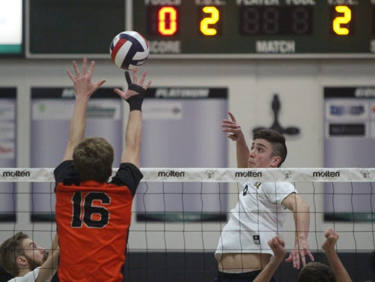 David Kopriva takes a swing for Marquette with Kaukauna's