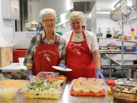 Nancy Hrabe (left) and Molly Schwartz serve up lunch