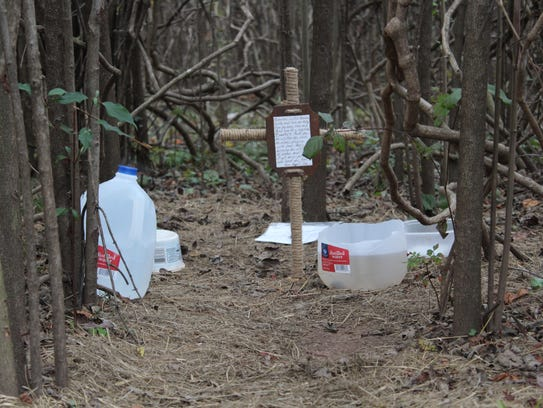 A cross with a note has been erected in the woods along the Clyde Fant bike trail that a dog has called home for more than two years.