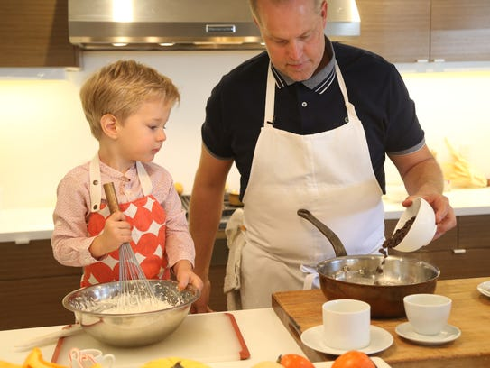 Chef Aaron Chamberlin (Right) pours chocolate chips
