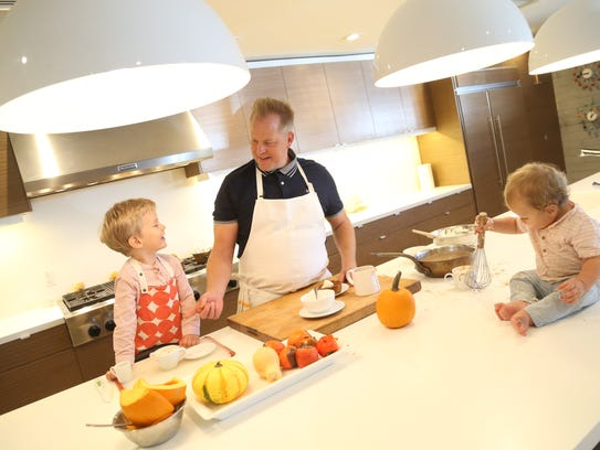 Chef Aaron Chamberlin (center) cooks with his sons