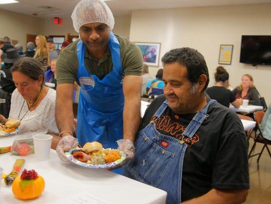 Pankaj Patel serves Richard Herrera at Interim's OMNI
