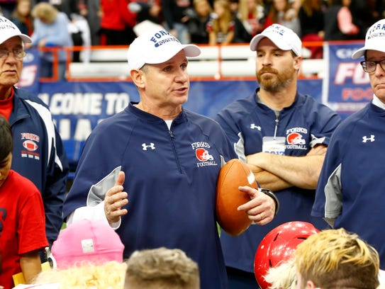 Chenango Forks' coach, Dave Hogan speaks to his team