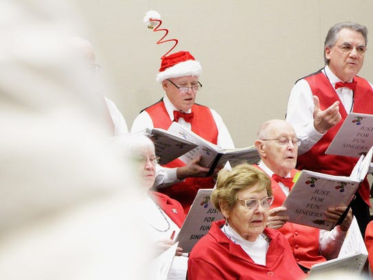 The Just For Fun Singers sing Christmas carols at the Salem Convention Center Annual Holiday Tree Lighting ceremony on Sunday, Nov. 26.