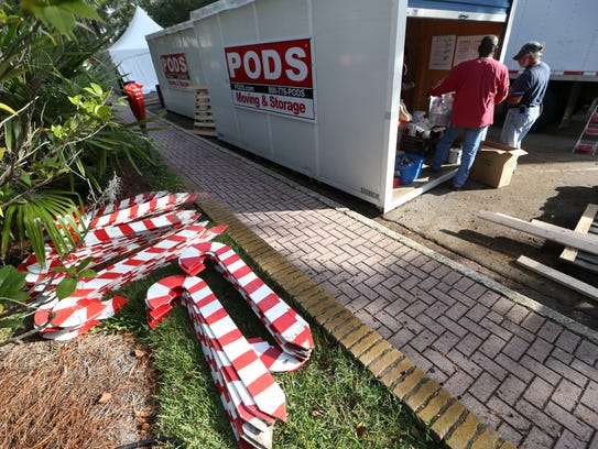 Workers erect the stages for the Candy Cane Lane display