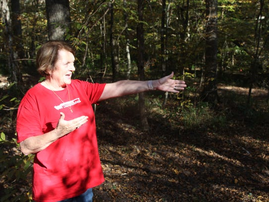 """Eve Haney points out a ravine which acts as a berm for target practice on her property off Timberlane Road. Neighbors have complained about gunfire on the 17-acre parcel. """"I only want safety,"""" she said. """"I'm really strict about our rules down there."""""""
