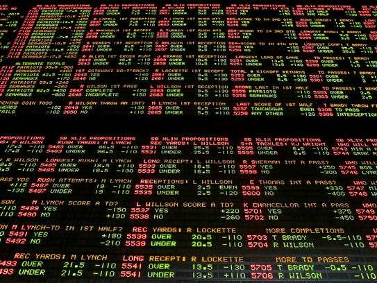 Super Bowl proposition bets are displayed on a board