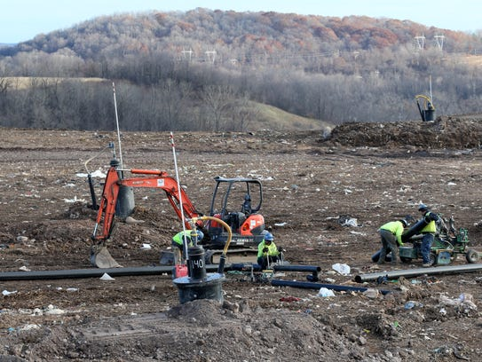 High Acres captures methane gas, a byproduct of landfills, by constructing both vertical and horizontal wells. Here pipe is being welded together for a horizontal system that will be covered by municipal waste.