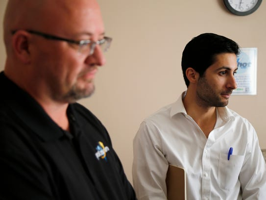 Palarum director of operations Marc Roderick (right) and director of training Mike Gilkison talk with a patient at Madison Health in London, Ohio, on Tuesday, Oct. 31, 2017. The wirelessly connected socks made by Lebanon-based Palarum are being tested in the central Ohio hospital to prevent patient falls resulting in injury.