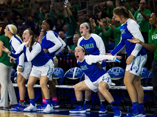 The Florida Gulf Coast University bench celebrates their 70-64 victory over the University of Kentucky at Alico Arena in Fort Myers on Friday.