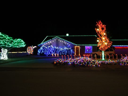 A range of colorful lights are on display at this house located at 4005 Lilac Drive.