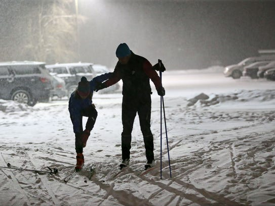 Tom Cousland of the town of Delafield and his daughter Sammi Cousland get ready to head out on the cross-country skiing trails of Lapham Peak State Park last year.