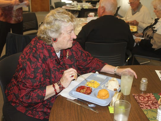 Jeanne Nolte enjoys her dinner Tuesday, Dec. 5, at
