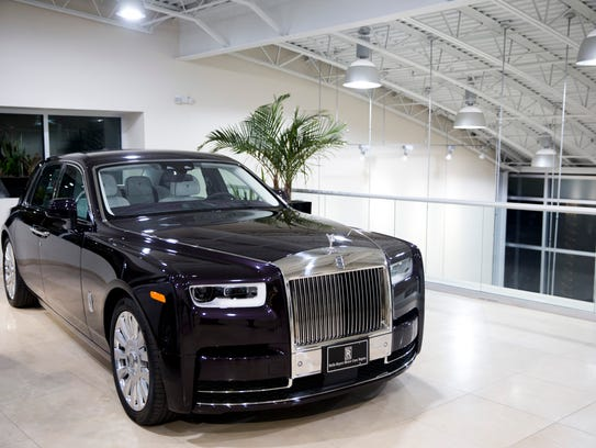 A one-of-a-kind Rolls-Royce Phantom is admired by potential