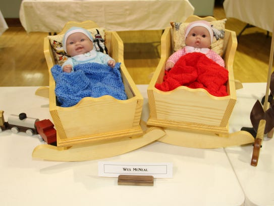 Tellico Village Woodworkers crafted these doll cradles,