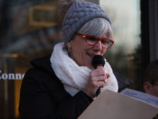 Jane Olisar, chief development officer at Three Pillars in Dousman, welcomes guests to the inaugural Love Lights tree-lighting ceremony.