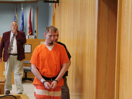 Kyle Engen is led out of Portage County Circuit Court