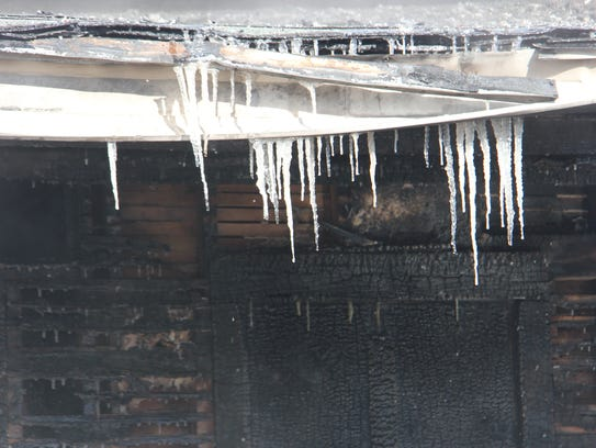 Icicles cover a Bolivar home after firefighters extinguished